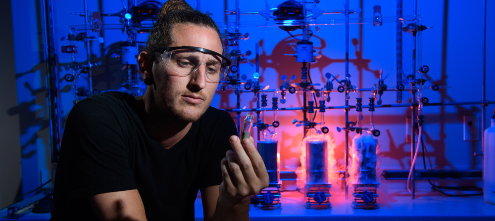 A scientist inspects a substance in a lab